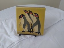 Yellow penguin tile by Motawi TIlework