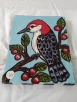 Red bird wall hang by Toni & Jay Mann