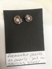 Freshwater pearls set in sterling silver earrings by Anonymous