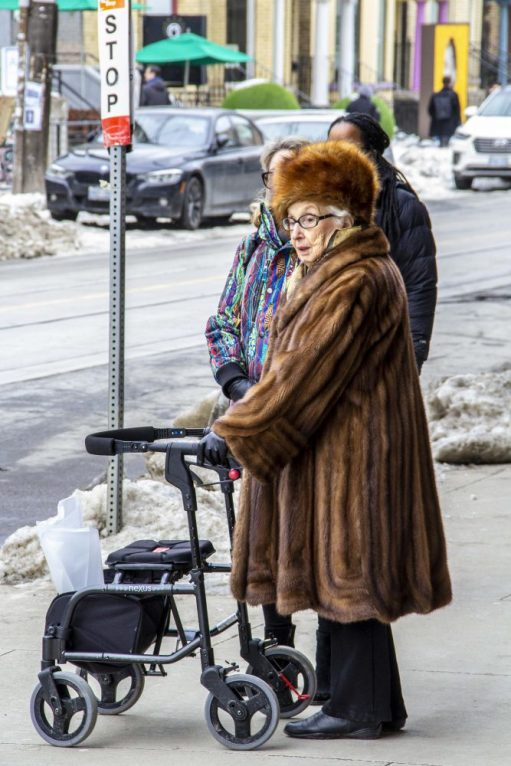 Only a dame from this generation can get away with fur head to foot! Outside the AGO