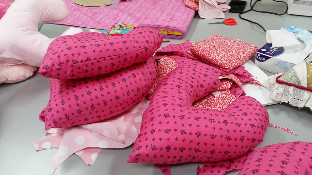 Sewing heart pillows for breast cancer