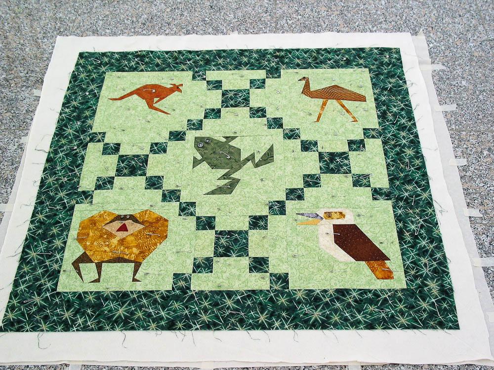 Paper pieced Aussie Quilt with kangaroo, emu, frog, frill necked lizard and kookaburra