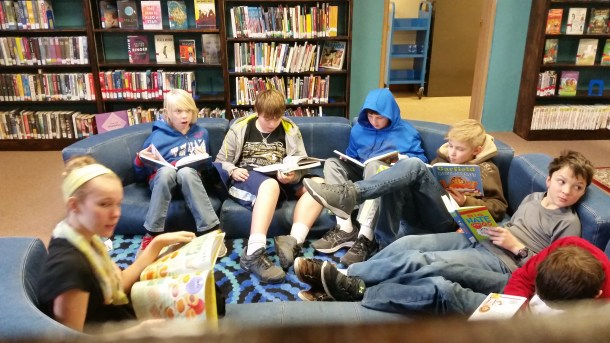 Mr. McCan's class takes a break to sit down and crack a book