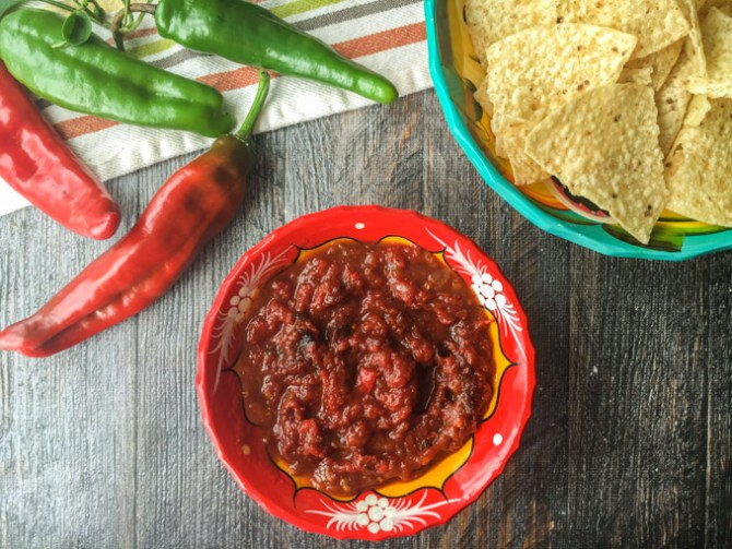red and green peppers with bowl of homemade salsa