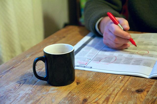 photo of newspaper- job searching