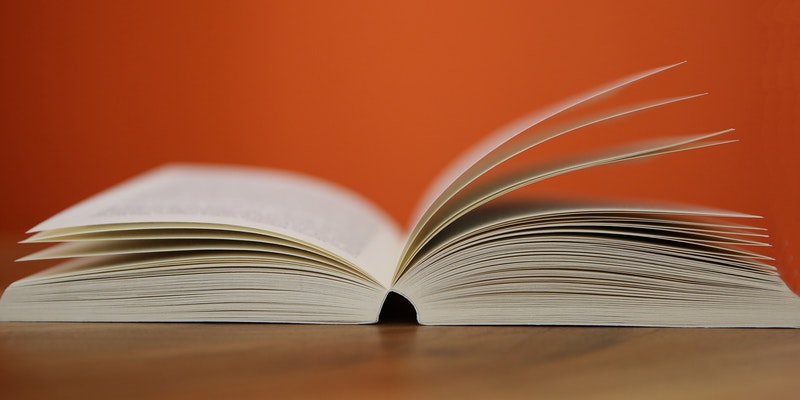 Open book with orange background
