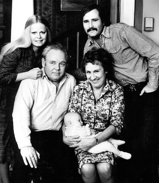 Photo of the Cast of the television program All in the Family. Standing are Sally Struthers (Gloria) and Rob Reiner (Michael); seated are Archie (Carroll O'Connor) and Edith (Jean Stapleton), who is holding the child who played the Bunker's grandson, Joey.
