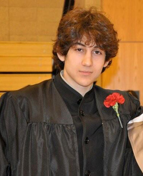 The remaining suspect in the Boston Marathon bombings has recovered enough to walk and assured his parents in a telephone conversation that he and his slain brother were innocent, their mother told The Associated Press on Thursday.