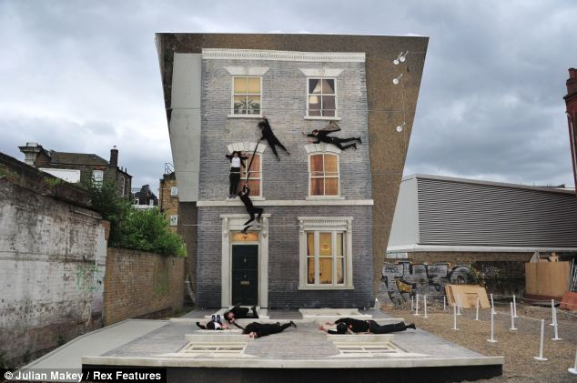Mirrored house illusion in Hackney street