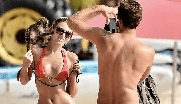 Paulina Gretzky Poses In Red Bikini With A Monkey While In Barbados (photo The Daily Mail)