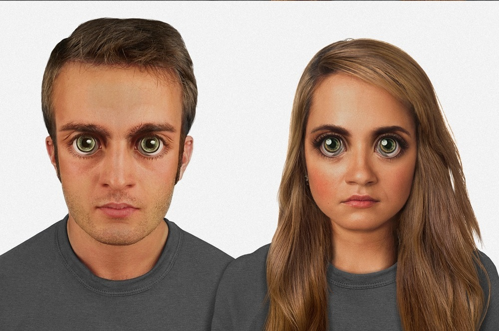 """In 100,000 years: The human face is proportioned to the 'golden ratio,' though it features unnervingly large eyes. There is green """"eye shine"""" from the tapetum lucidum, and a more pronounced superciliary arch. A sideways blink of the reintroduced plica semilunaris seen in the light gray areas of the eyes, while miniature bone-conduction devices implanted above the ear work with the communications lenses on the eyes. Image credit: Nickolay Lamm"""