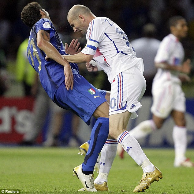 Zidane plants his brow into Materazzi's chest