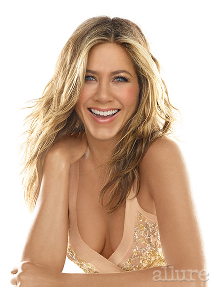 For this shot (the cover), hairstylist Chris McMillan combed a mixture of mousse and shine serum through Aniston's damp hair. He straightened just her roots and scrunched the bottom half of her hair with his hands while he dried it with a diffuser. To play up Aniston's golden look, makeup artist Charlotte Tilbury swirled bronzer along the sides of her face and apricot blush on her cheeks. She chose a palette of gold and bronze shadows for Aniston's eyes and layered shimmery bronze gloss over berry lipstick. The look can be re-created with Colour Riche Eye Shadow in Treasured Bronze, True Match Super-Blendable Blush in Soft Sun, and Colour Riche Le Gloss in Nude Touch by L'Oréal Paris.