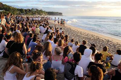 People gather on the beach in Les Aigrettes, on the western coast of the French Indian Ocean island of La Reunion on April 12, to pay tribute to a 13-year-old boy who was attacked and killed by a shark today.