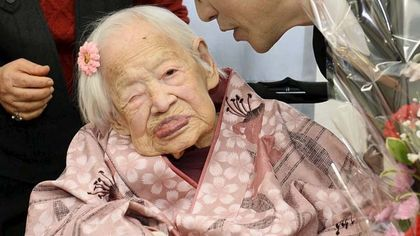 Misao Okawa, the world's oldest living person, celebrates with Takehiro Ogura (R), mayor of Osaka's Higashi-Sumiyoshi Ward, on the eve of her 117th birthday at an elder care facility in Osaka, western Japan in this file photo taken by Kyodo March 5, 2015. Okawa died in Osaka on April 1, 2015 early morning, Japanese local media reported. Mandatory Credit REUTERS/Kyodo/Files