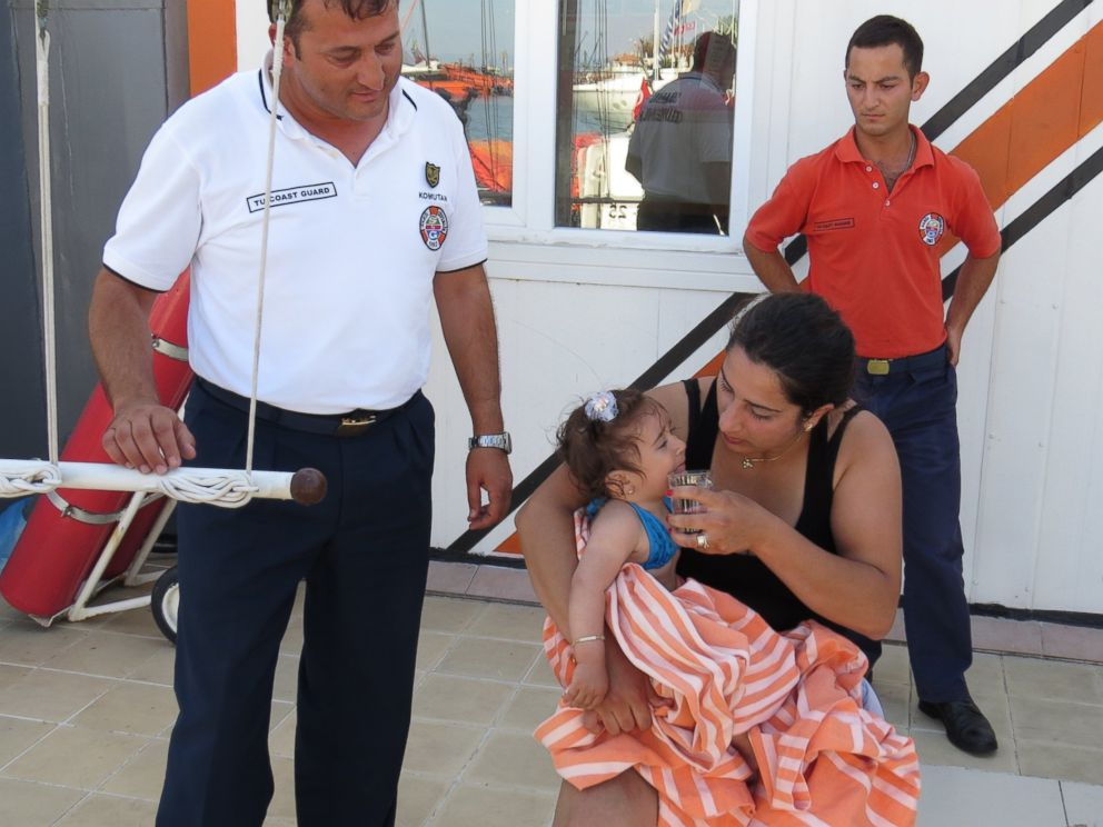 PHOTO: Ten-month-old baby Melda Ilgin is seen on her mother's lap after being saved by Turkish coast guard when she drifted a kilometer out to sea on a sea buoy in Ayvacik district of Canakkale province, Turkey, July 3, 2015.