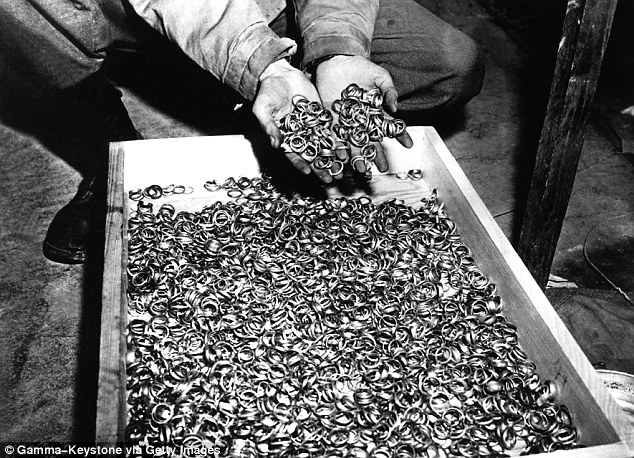 Thieves: The Nazis were known for their hordes of gold, so the story was not implausible. This picture, taken on April 8, 1945, shows American soldier discovering a box full of rings of deportees taken on their arrival