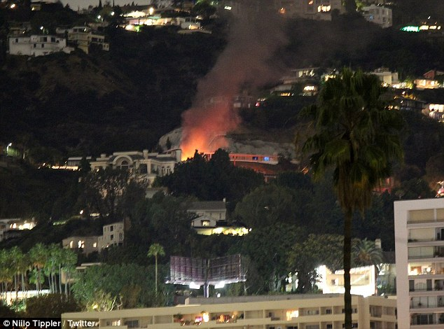 According to the Los Angeles Times , the home caught fire shortly after 5.30pm, and was put out in about half an hour by more than 40 firefighters