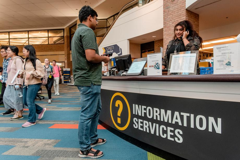 The 2nd floor Information Desk, where students and staff of the U-M AAEL (Library), CAEN, and DMC are ready to help