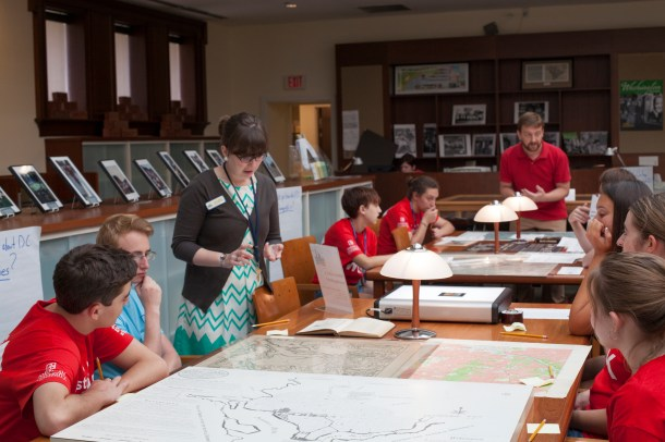 HSW Research Services Librarian Laura Barry, volunteer Brian Rohal, and Collections Manager Anne McDonough led round-robin sessions during the students' visits. Each table presented a concept (e.g. Who is a Washingtonian? Where's D.C.'s Missing Piece?) and several resources for the students to explore.