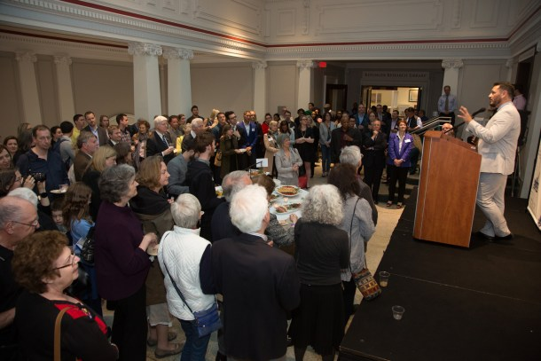 Executive Director John Suau welcomed nearly three hundred people to the exhibit opening on April 22.