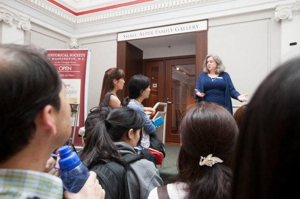 Intern Susan Philpott, a candidate for a Masters in Public History, welcomed the visitors to the Small-Alper Gallery.