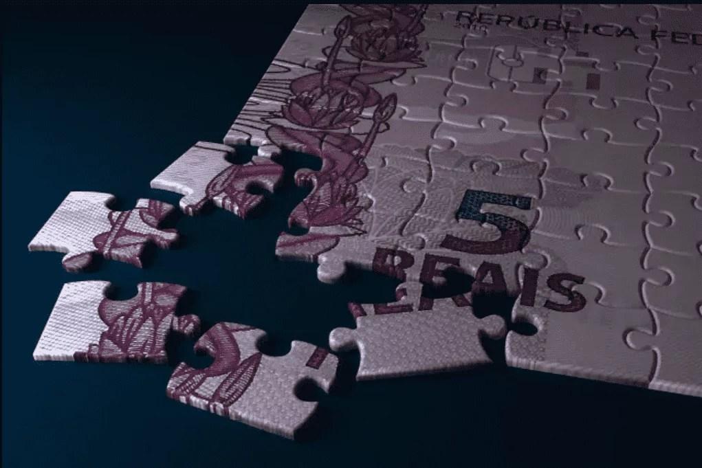 Foto mostra uma quebra-cabeça que forma uma nota de cinco reais.