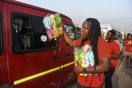 Edem selling 3 - Photos & Video: Rapper Edem Spotted Selling In Traffic