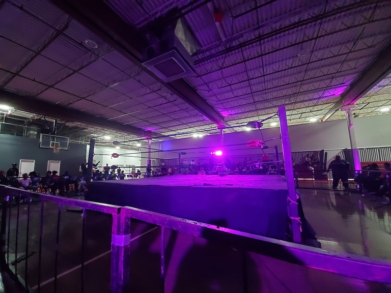 A wrestling ring in purple lighting