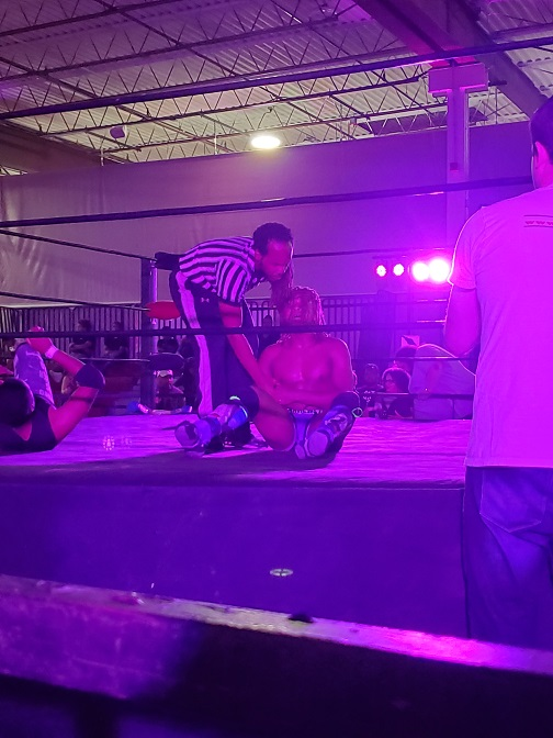 Man sits in wrestling ring