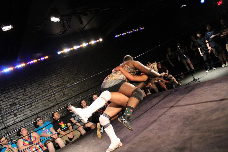 Two pro-wrestlers wrestling