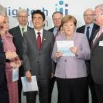 presenting Chancellor of Germany, Angela Merkel with the final report by the Fachforum Autonome Systeme