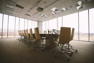 Empty boardroom with floor to ceiling windows