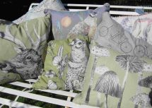 Contemporary designs of cushions in pale greens, grey and pastel colours.