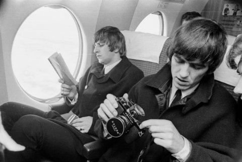 The Beatles in New Zealand. Ringo Starr and George Harrison on board an aircraft during their tour of New Zealand, June 1964