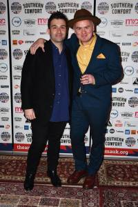 Award winners Ben Glover and Dean Owens in font of the Americana Music Association UK Awards boards in the reception area