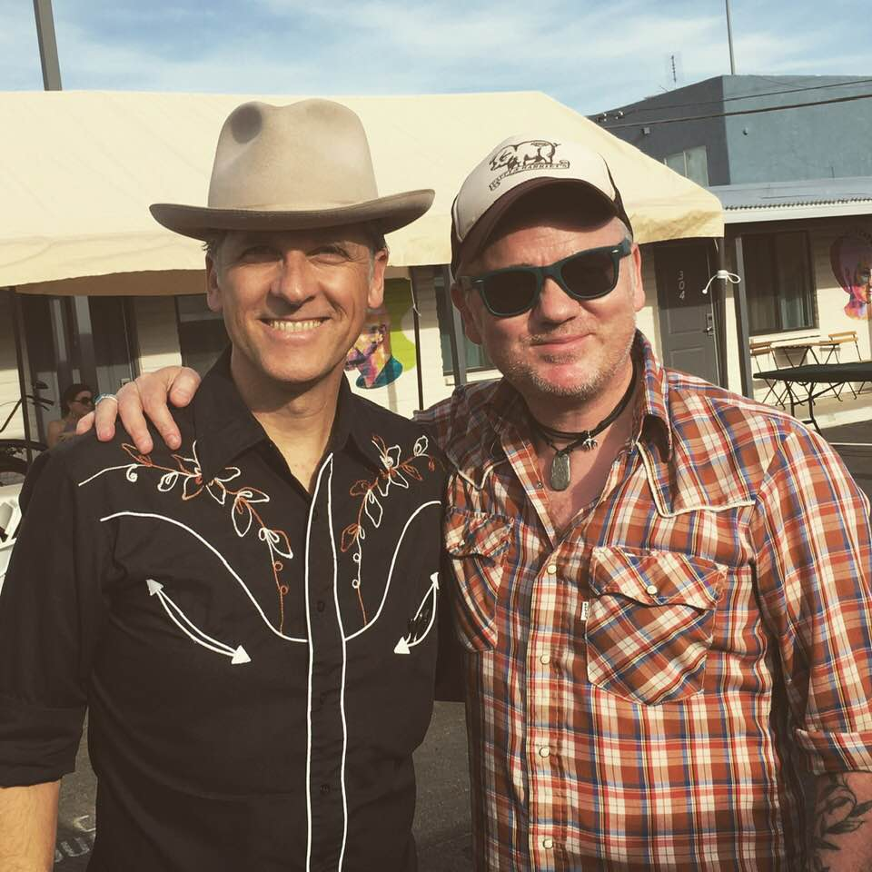 Joey Burns (Calexico) and Dean Owens standing at a festival in Tucson AZ
