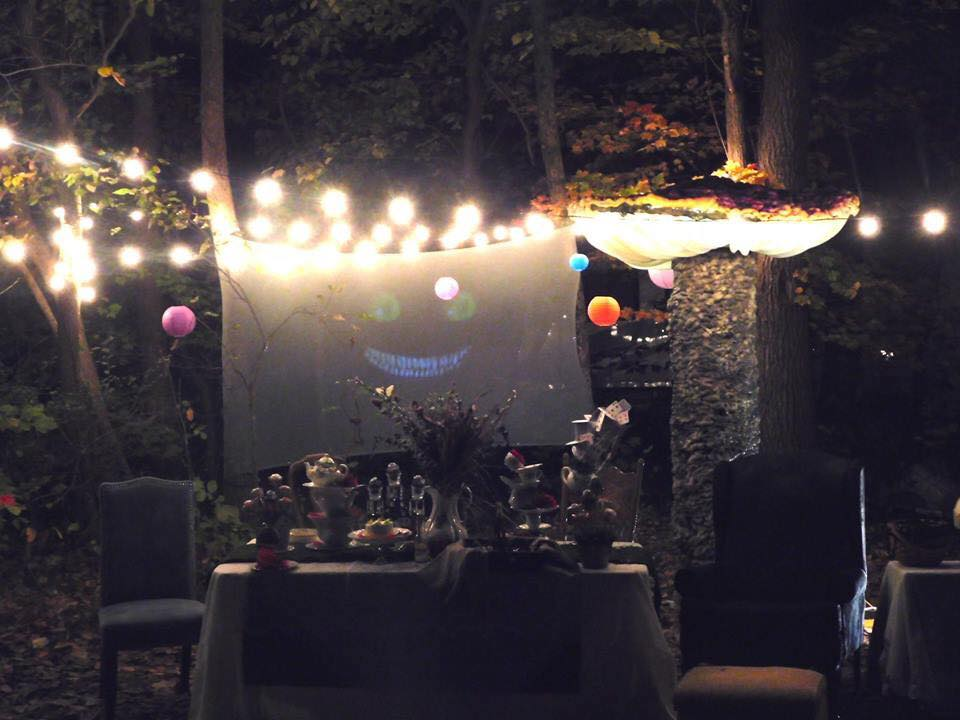 Night view of the Mad Hatter Tea Party with Cheshire Cat