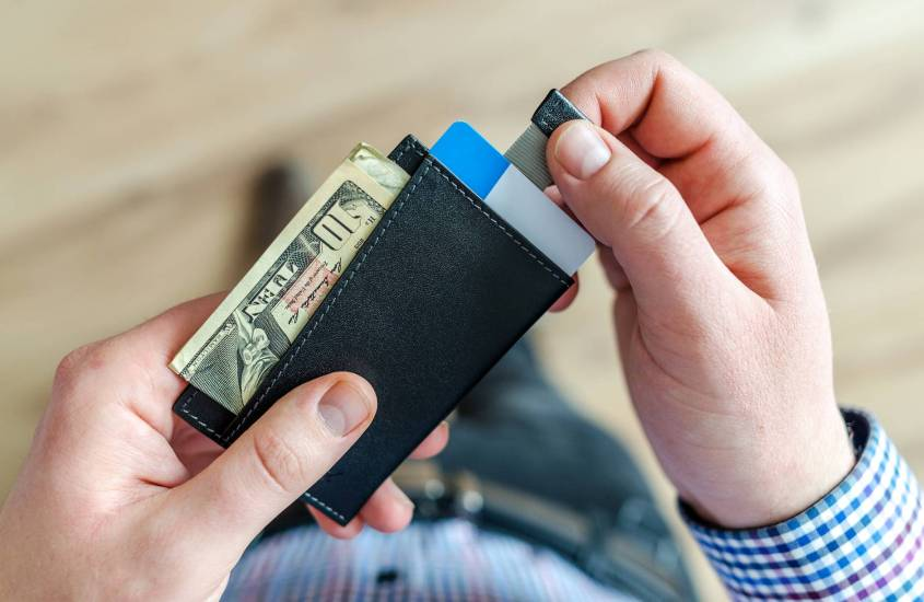 person holding black card holder