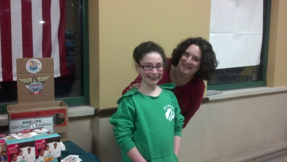 Serena and her mentor mom working the Girl Scout Cookie table at Shop-Rite