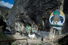 Buddhist paintings on the rocks above the river