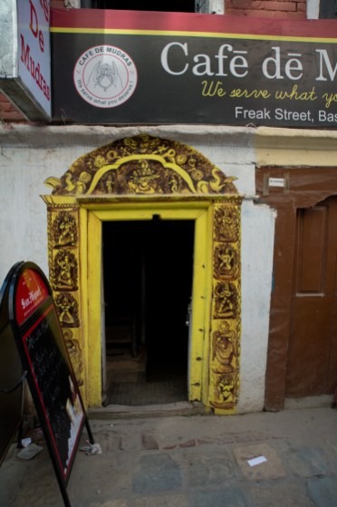 Entrance of a cafe with beautiful carving at the door entrance