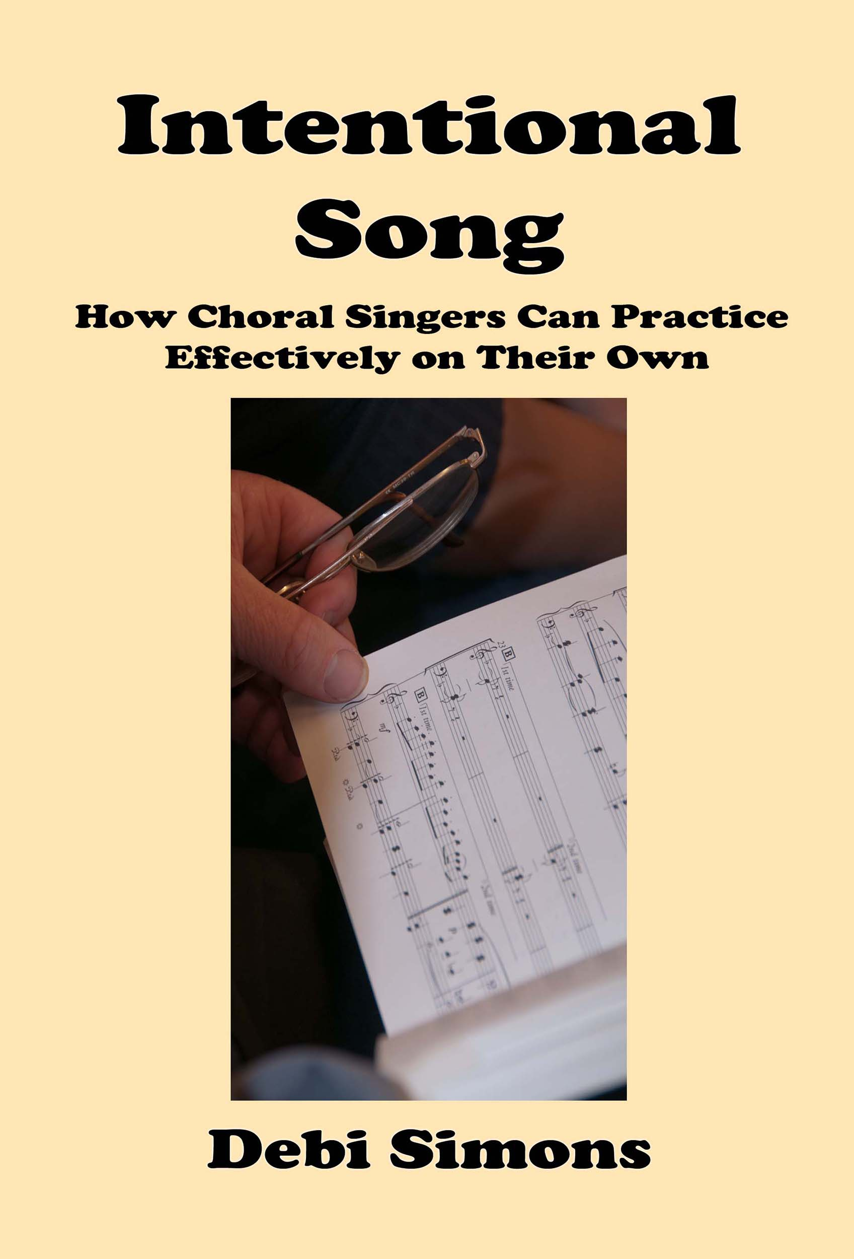Intentional Song cover with picture of hand holding glasses and turning a page of music