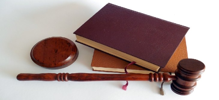 Law book and wooden gavel
