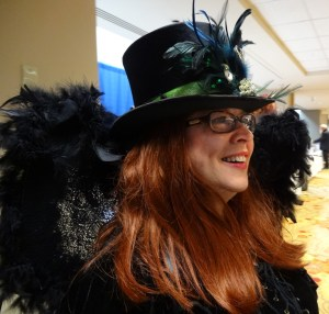 Author Sibelle Stone enjoys dressing up and wearing hats.