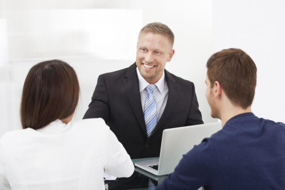 Financial Advisor Discussing With Couple