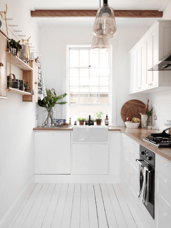 13-tiny-house-kitchens-that-feel-like-plenty-of-space-white-kitchen-56d85e484bdbdc425ea9527a-w620_h800-1