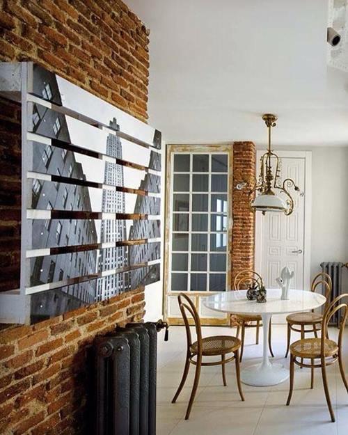 Un original cuadro con foto: muebles con palets reciclados que dan un aire nuevo a tu casa.