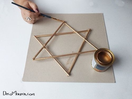 Estrellas de Navidad DIY con palitos y cuerda 10