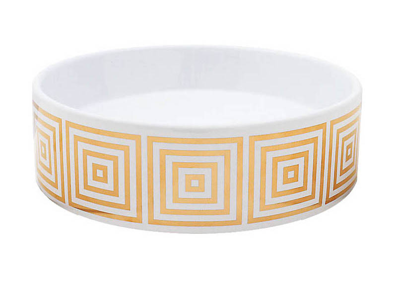Big Squares in Gold on a petite round vessel sink.